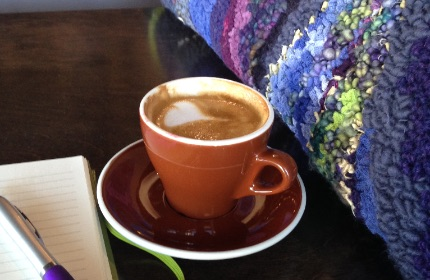 Hand-hooked rug with journal, pen and latte