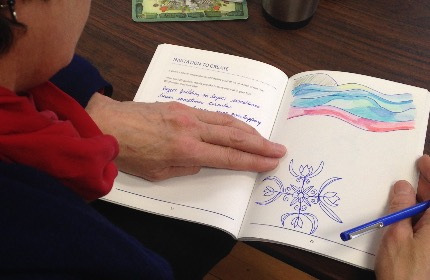 Woman writing and sketching in journal