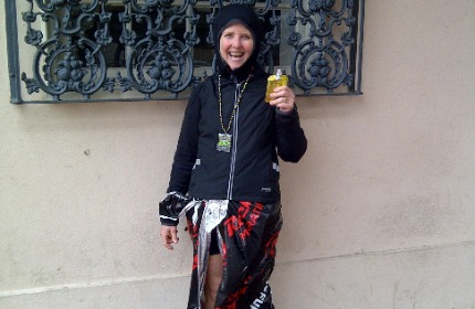 Smiling woman wearing running gear, a black hoodie and a medal from the New Orleans Rock n Roll half marathon